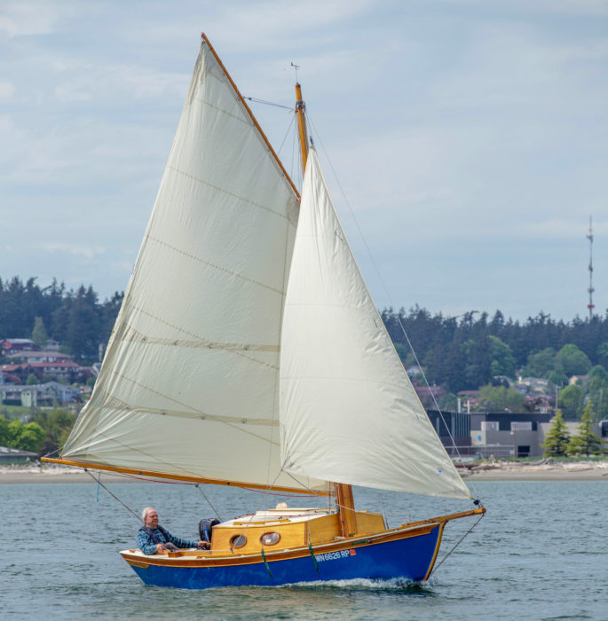 The rig has its complications—four halyards and five stays—but the 20' mast pivots on a bolt in a tall and beefy tabernacle, which makes it reasonably easy to raise and lower. NIL DESPERANDUM's solid spruce mast weighs 40 pounds, but hollow birdsmouth construction would save about 15 pounds.