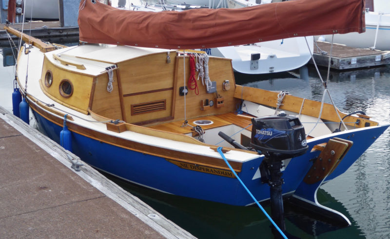 The Winter Wren II ill take an outboard between 2 and 4 hp. The slot in the transom for the mount is narrow and the motor is fixed against rotating. Steering is done with the boat's rudder.