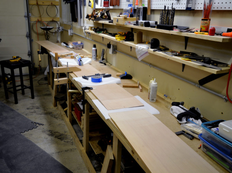 To make it easier to assemble the plank sections, Harvey built a long worktable along one wall of the garage.