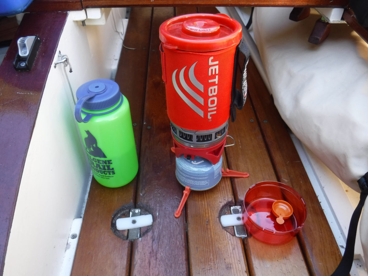 With the pot locked on the stove and a folding tripod base clipped to the fuel tank, the Jetboil system behaves it self while cooking at anchor with the boat rocking.