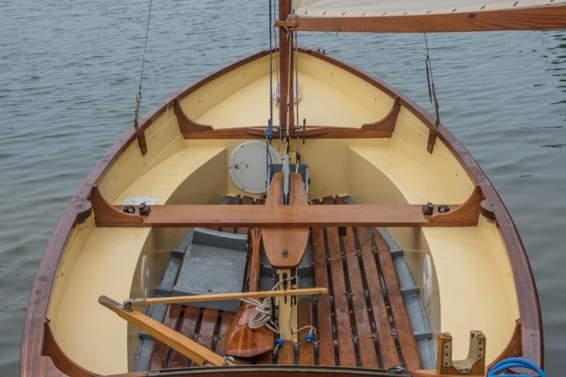 "In the original boat the plank were clench nailed to the frames through the laps. Here they are riveted. A single copper clench nail secures the laps between frames. These planks have glued scarfs; the drawings show plank sections joined by scarf joints set in varnish and held with clenched 1/2"" copper tacks."