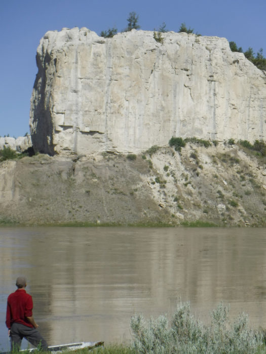 Across from a primitive but popular campground at Eagle Creek, white cliffs tower over the riverbanks.