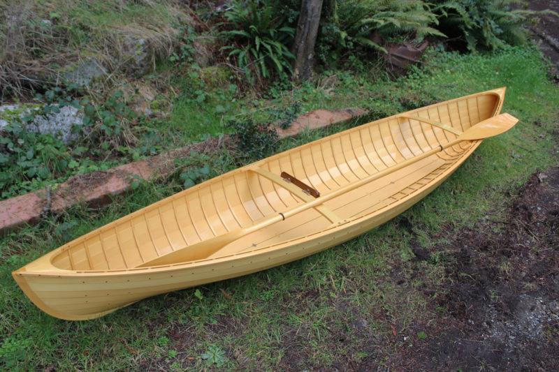 The 37 steam-bent frames give a traditionally planked hull the look and appeal of the double-paddle canoes of the 19th century. Glued-plywood lapstrake construction has the advantage of a more easily maintained interior.