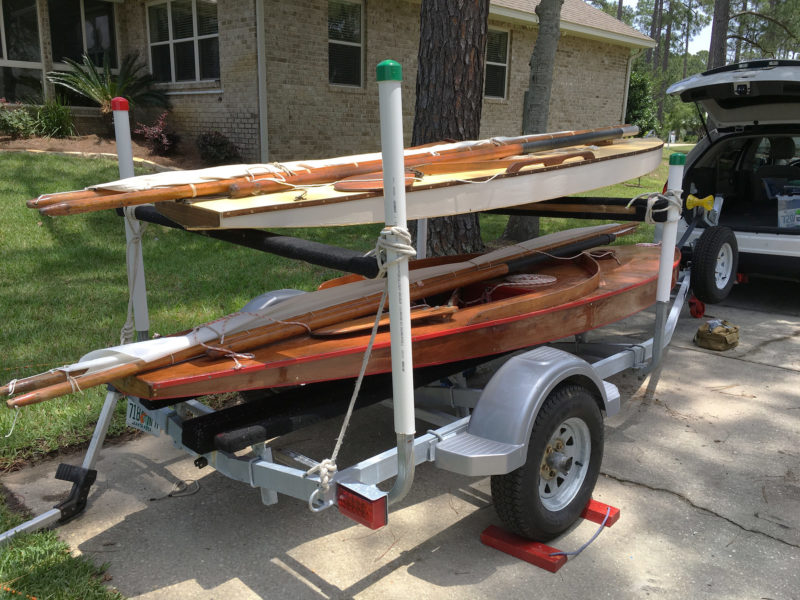 For our double-decker trailers we've had crossbars bolted to the guide posts. To make this trailer more easily convertible, we cut slots in the PVC-pipe covers and installed galvanized eye bolts in the guide posts. Lashing the crossbars takes just a few minutes. This works for light boats; bolted brackets are stronger and best for heavier loads on the upper deck.