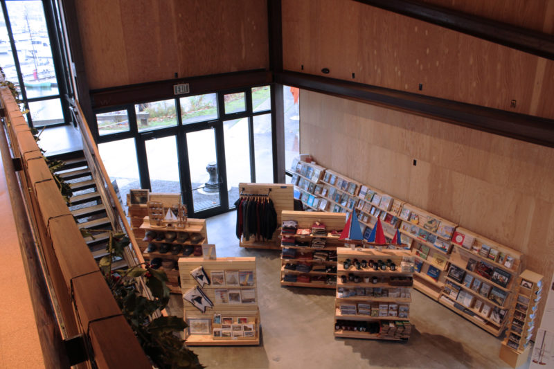 At the main entrance there is a shop carrying a wide selection of books and magazines. That includes Small Boats 2019 in the the upper right-hand corner of the back bearing the CWB burgees. The stairway at left is made with treads cut from the keel timbers of WAWONA.