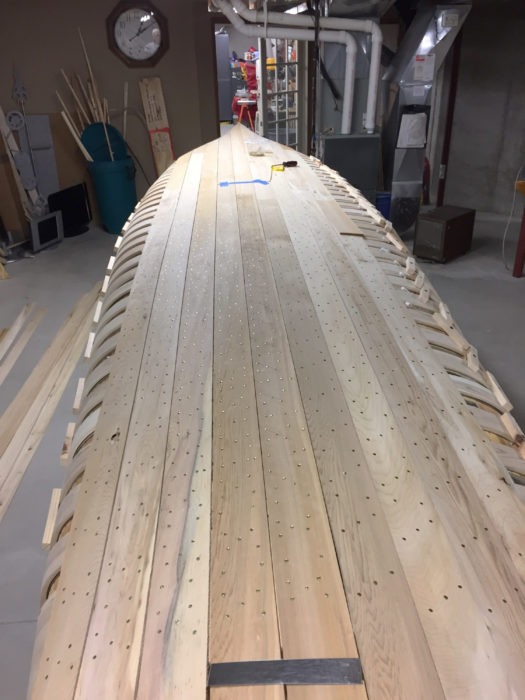 Much of the planking can be applied with very little trimming to achieve a tight edge-to-edge fit. The planks will be covered with canvas, so there's no need for lining off planks for appearance's sake.