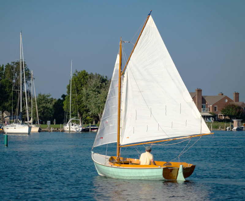 The gaff sloop rig carries 92 sq ft of sail in the main and 32 sq ft in the jib.