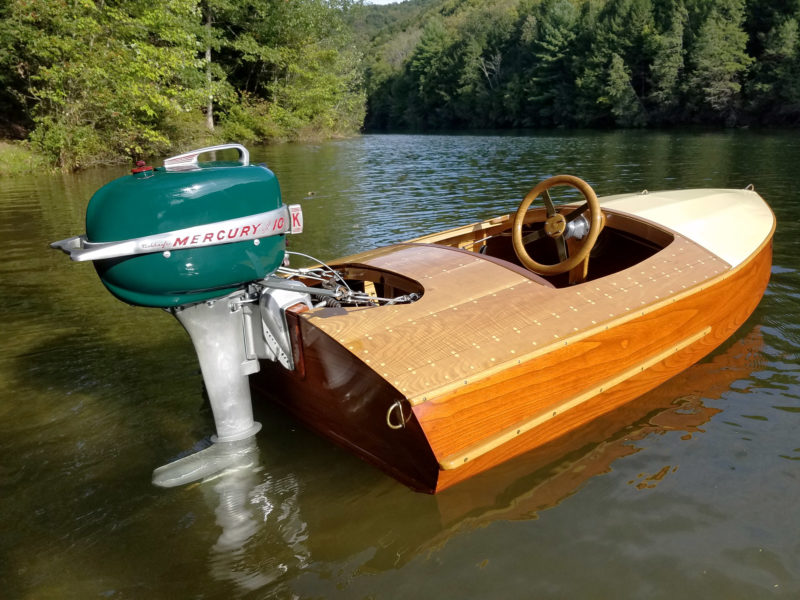 The transom eyes, wheel, and foredeck fittings were part of the vintage look of the 10' runabout.