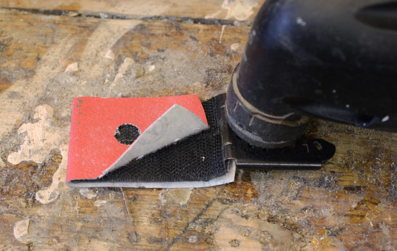 To get around having to stock and pay for the sandpaper pads for the sanding-pad attachment, I covered a multi-tool saw blade, bottom and top, with self adhesive hook-and-loop fastening tape (hook side). For sandpaper I cut rectangles from sanding disks, often times disks that I've already used on a random-orbit sander. The perimeters may be worn, but the centers are usually still useful.