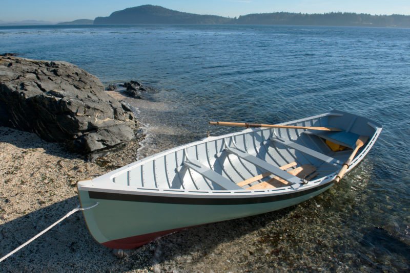 There are three thwarts in the dinghy, but only two are rowing stations. The boat was originally commanded by a solo rower, who took the center or forward thwart as the load and boat trim required.
