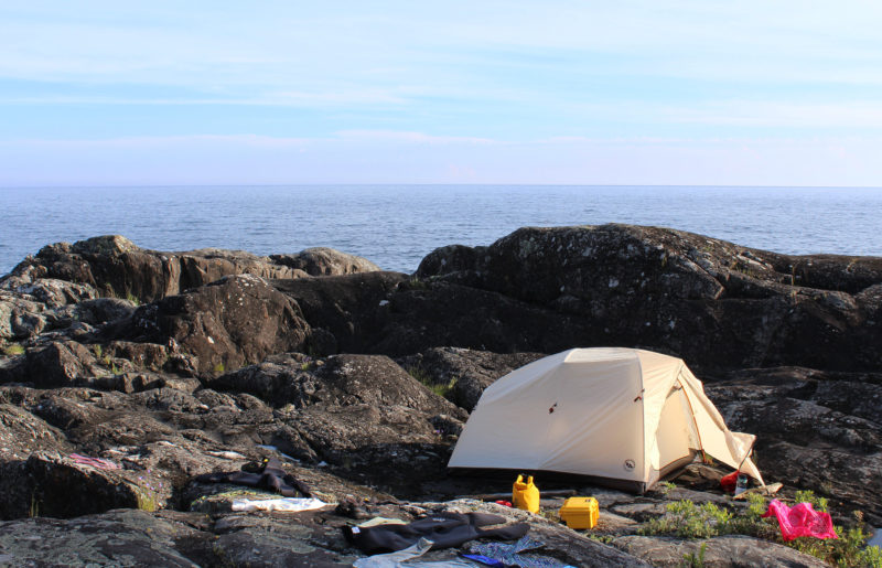 We spent a night perched on an uneven rock plateau high above the water in Pukaskwa Provincial Park. With no beaches in sight we had clambered up the vertical and jagged rock pile. After passing items up one by one then slowly lifting empty boats up upon the rock, we pitched our tent on the least lumpy patch of rock.