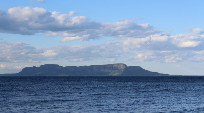 We spent days sitting on the Canadian Pie Island waiting to do the 6-mile crossing of Thunder Bay to the majestic Sleeping Giant. It is said that that the formation looks like a giant sleeping on its back. Looking from right to left, we could see the outline of a head, followed by shoulders, down to a hip, bent knees, and feet. The formation rises over 1,800' high, and even across 6 miles of water it is an imposing figure.