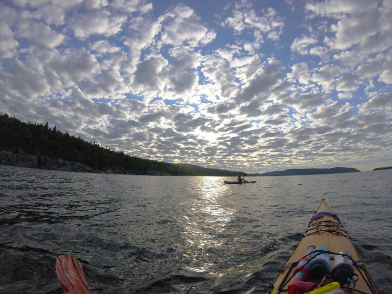 We paddled into a quiet evening in the calm after the storm. The sunset against a speckled sky took our breath away as we drifted toward Grand Marais, Minnestota, to resupply. The distant, lumpy landscape casts a contemplative spell as we prepare for the rugged Canadian portion of our journey.