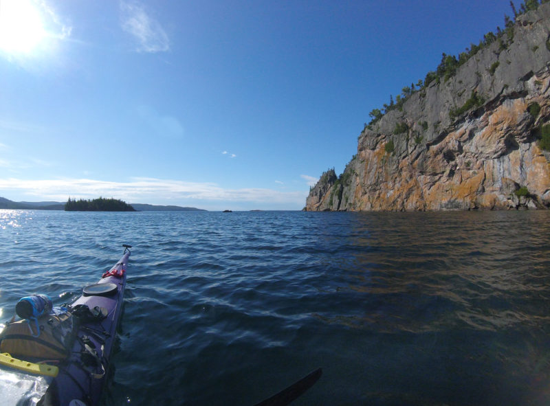 On a sunny bluebird day, the cliffs in in Ontario's Lake Superior Provincial Park towered over Old Woman Bay. Gentle swells lapped at the wall of rock, making a rhythmic thunking sound.