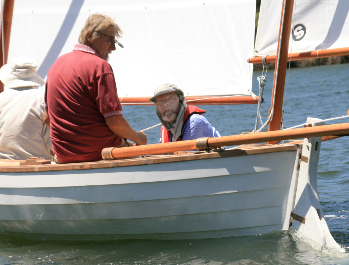 With JIM crewed by his friends, Peter takes JIM's helm for her first sail.