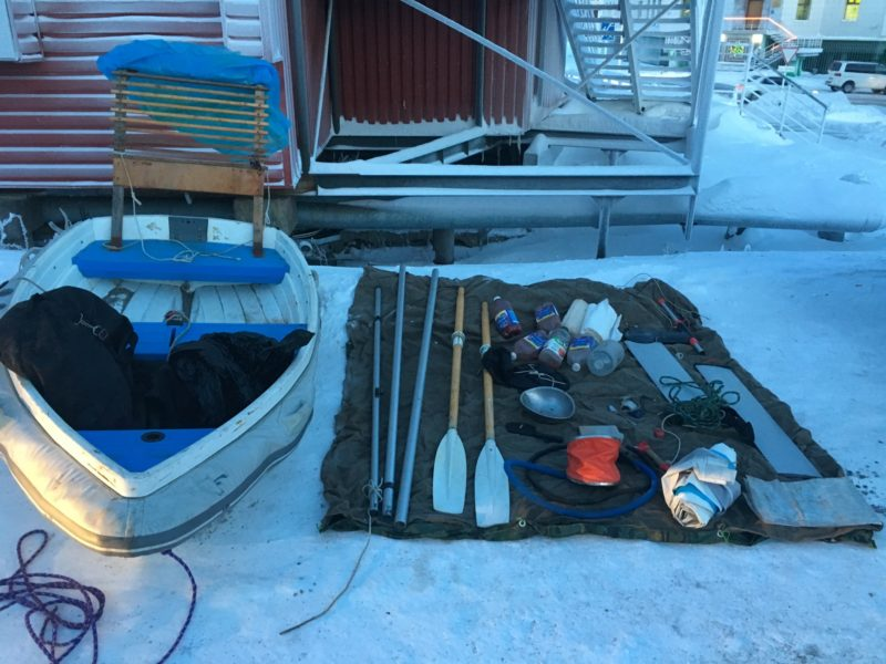 Walker Bay dinghy and gear laid out on a tarp in Russia
