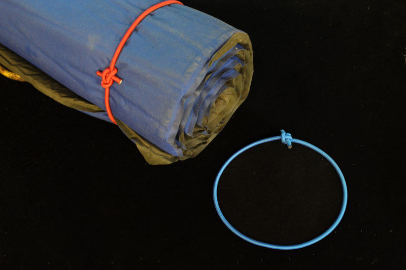 "A length of bungee with its ends tied together makes an oversized ""rubber band."""