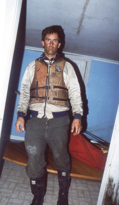 "I got a lot of use out of this PFD on my cruises, but all it ever did was keep me a bit warmer and help explain my grubby appearance when I walked into town: ""I'm not destitute; I'm boating."" Here, I'm two months into a wintertime river voyage. Behind me is my sneak box, hauled into an abandoned house in Mississippi that had half fallen into the Pearl River and lost it's living room's riverside wall."