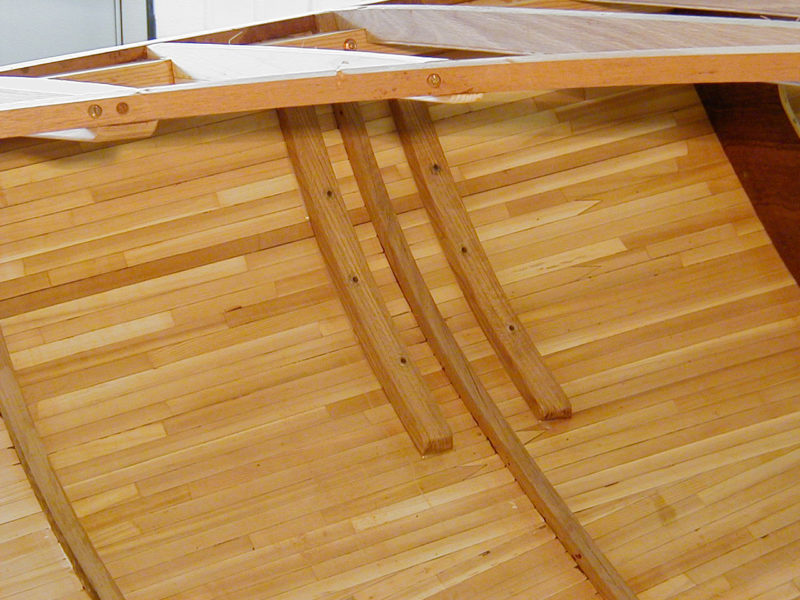 "Prior to painting, the inner layer of strip planks was evident. The two additional layers of diagonal planking make up the full thickness of the hull, just shy of 7/8""."
