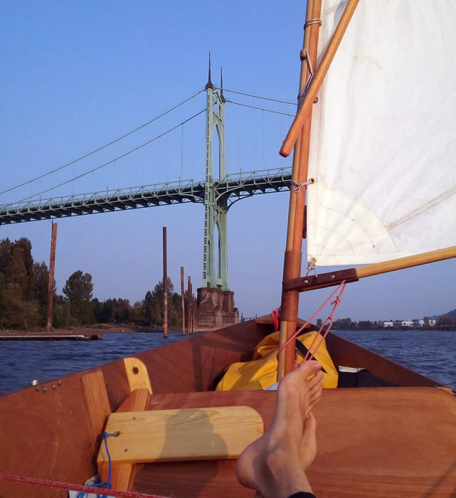 The St. John's bridge, the first on the approach to Portland, was bathed in the afternoon light as I sailed up the Willamette River. It was a downwind run, so I pulled the leeboard up and set it in the boat, just forward of my feet.