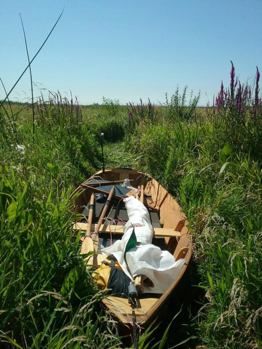 Lost in the weeds, the boat proves itself an amphibious vessel. For the overland trek, all of the gear was tossed in the cockpit.