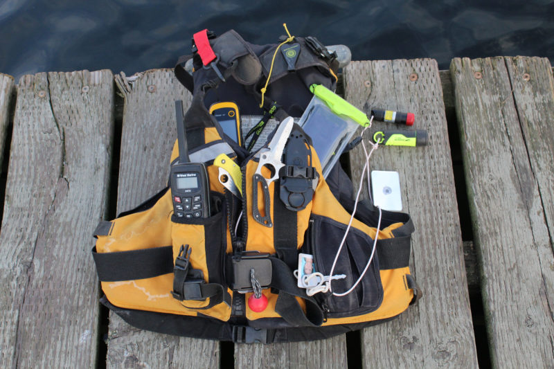 My current PFD, shown at the top with everything tucked away, has what I need to help someone in need, including myself.