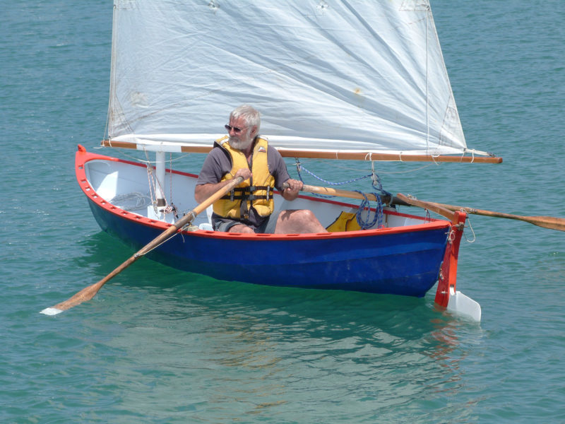 Designer John Welsford, seen here at the oars, rows several hours every week for exercise. He designed the Sei to row well not only for auxiliary power, but for pleasant outings when the sailing rig is left ashore.