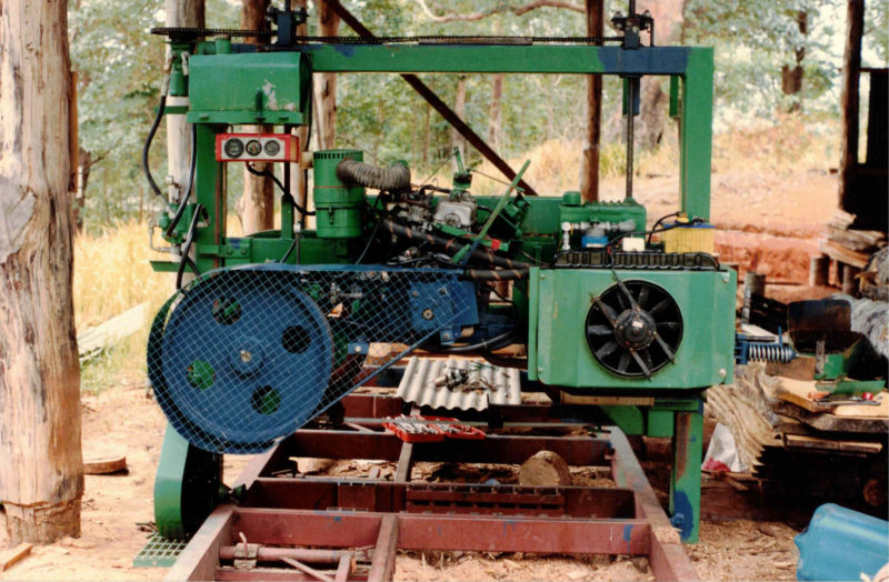 The bandsaw mill Peter built has hydraulic controls for easy operation.
