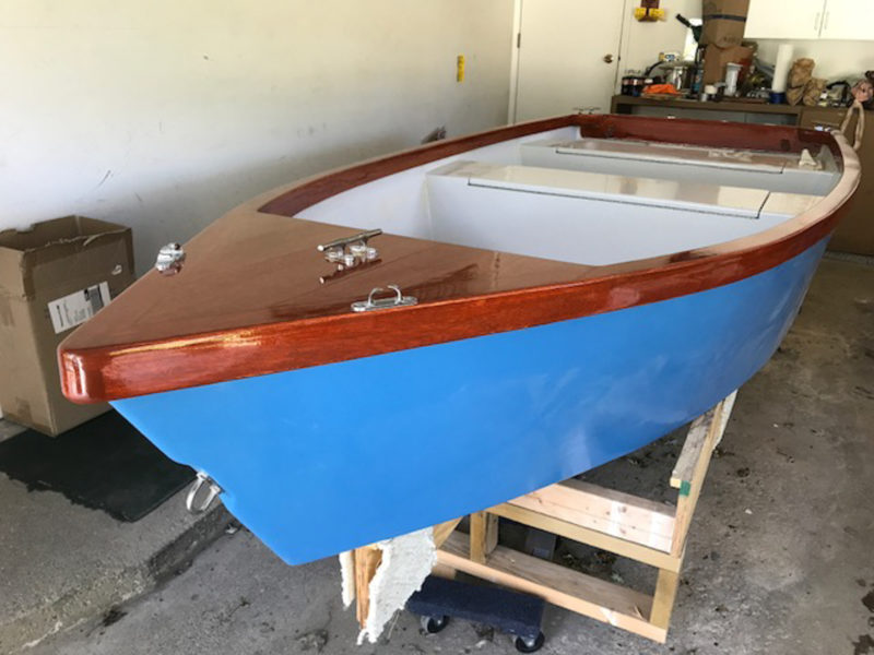 Grandfather Mark decided even a little boat meant for fishing deserved a touch of class and went for some mahogany, finished bright.