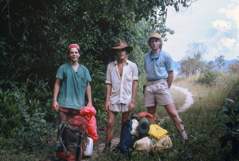 Brent Simpson, Ted Cooney, and Tom DeVries, (l to r) out in the noonday sun, were eager to find some shade on the two-day overland hike to Bongongo.