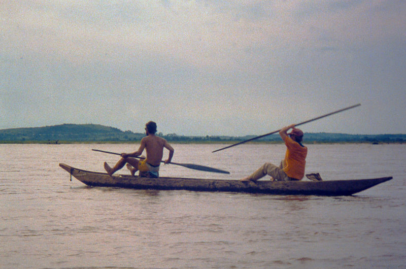 Greg Mock (left) and Keith Peterson often paddled FIFTY GOOD ONES canoe style. Only in overloaded pirogues did we see Zairians seated.