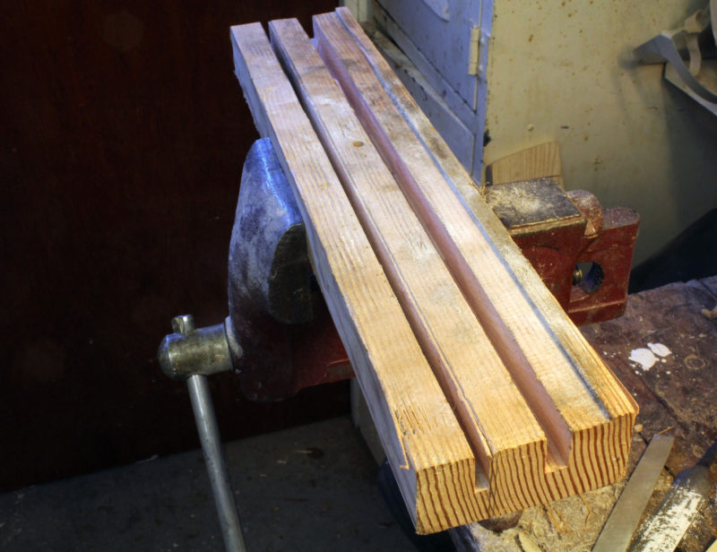 I work files with my vise holding a block of wood that I've run through the table saw to make a raised lip along to restrain files set on the flat and a couple of grooves to hold files on edge.