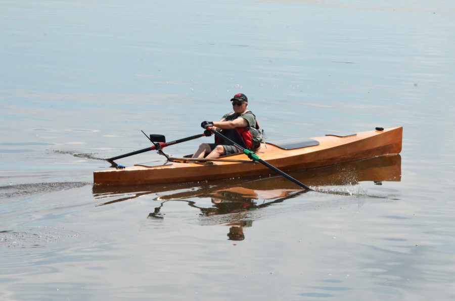 Jim Duff rows past the camera in an Expedition rowboat from Angus